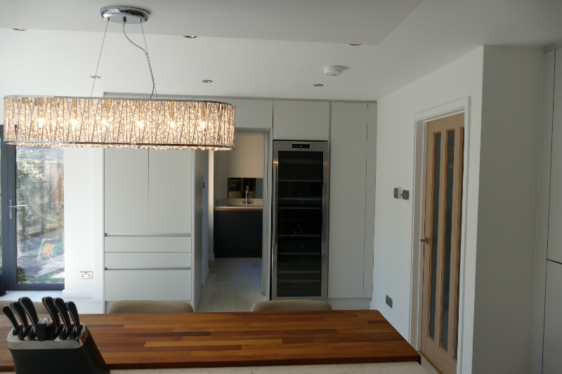 Kitchen extension Sandy, kitchen design Bedfordshire, kitchen design Hertfordshire, kitchen fitter, kitchen extension Bedfordshire, kitchen extension Hertfordshire, handleless kitchen, grey kitchen, open plan living, bi-fold doors